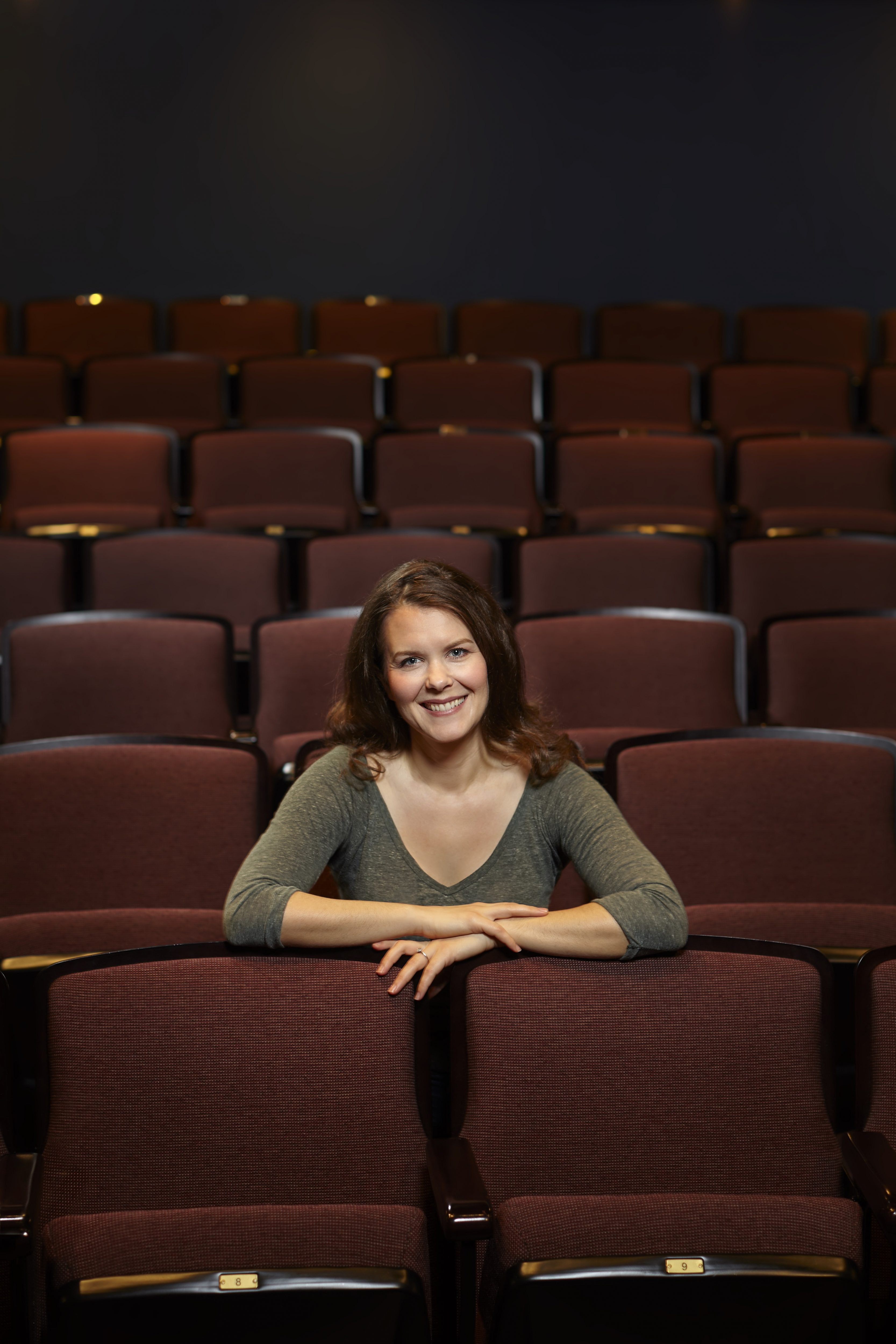 Celine Stubel sits with her arms folded across the back of the new seats.
